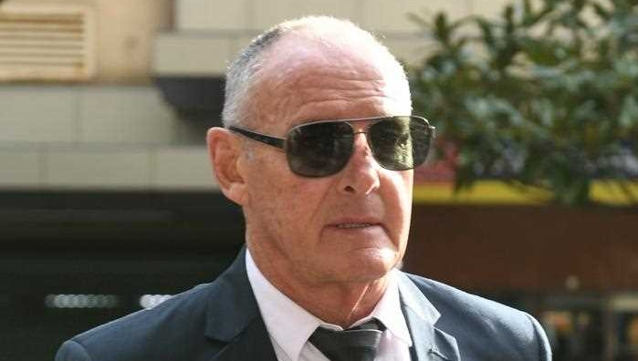 A man in sunglasses arriving at court.