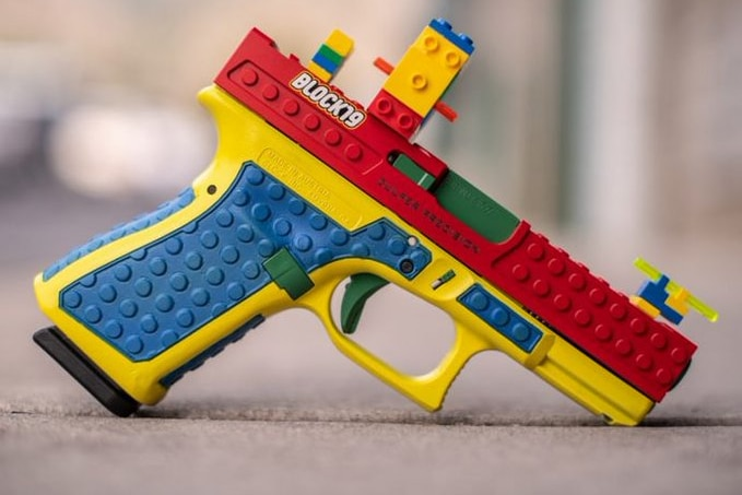 A blue, yellow, red and green covering for a pistol.