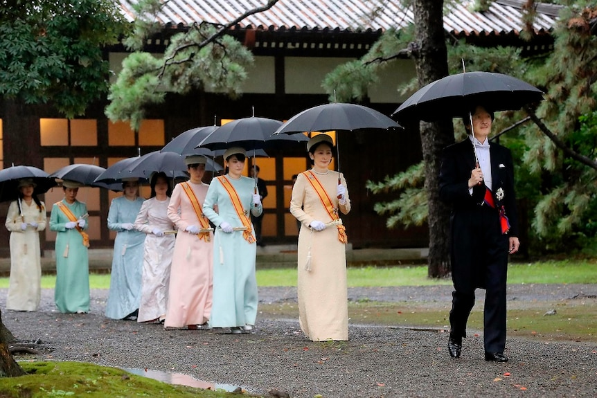 Japan's Crown Prince Akishino and Crown Princess Kiko arrive in colourful dresses to the enthronement ceremony.