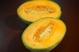 A rockmelon cut in half.