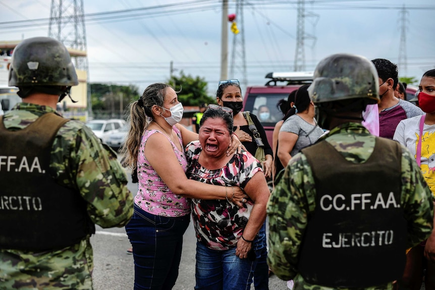 A woman reacts outside a prison where inmates were killed during a riot.