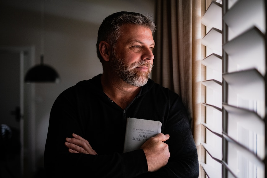 Former Jehovah's Witness Bill Hahn looks out a window.