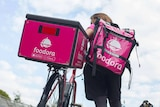 A Foodora delivery worker.