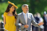Amal Clooney and George Clooney arrive for the wedding ceremony.