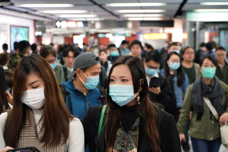 People wear masks at Hong Kong airport.