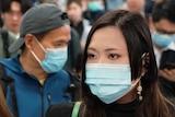 People wear masks at Hong Kong airport.