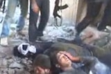 A still from footage showing Syrian government troops moments before they were killed by rebels.