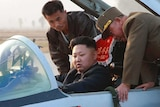 Kim Jong-un sits in a fighter jet.