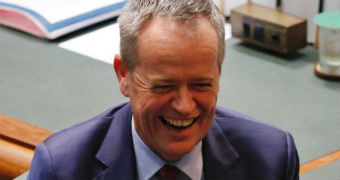 Bill Shorten laughs in Parliament.