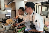 Two young men working in the kitchen of Pepper and Salt restaurant at Forest Hill winery.