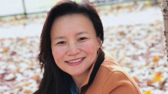 Cheng Lei smiles in a photo from before her arrest