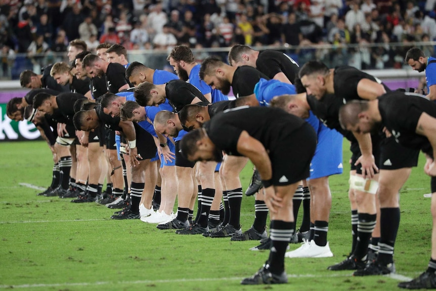 The New Zealand team bow to the crowd after their loss in their Rugby World Cup semi-final against England.