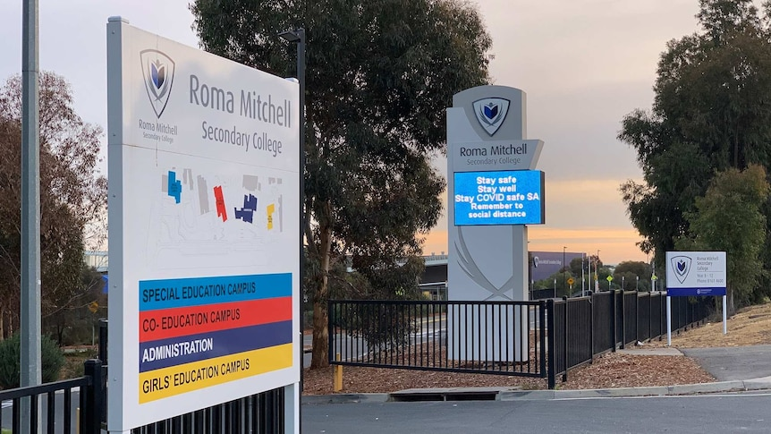 Signs at the entrance of a school