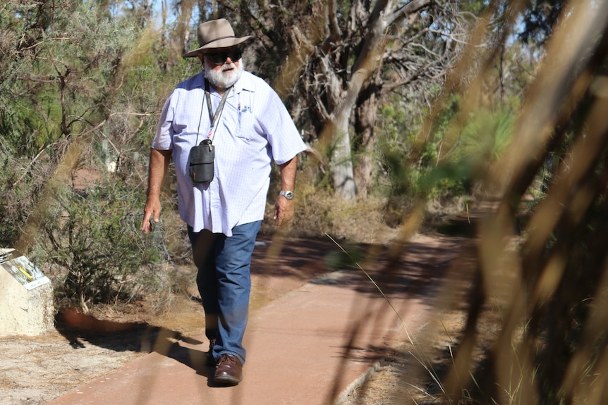 Noel Nannup walks through the Wireless Hill reserve in Perth