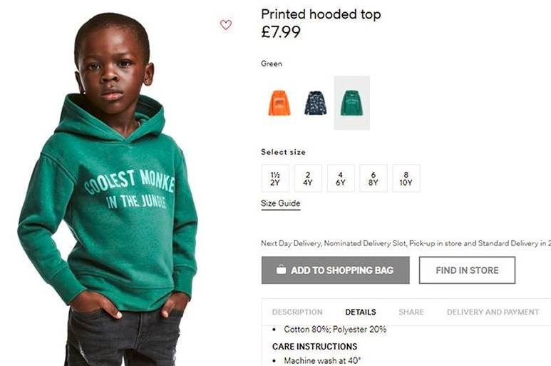 """H&M online advertisement shows black child model wearing a green hoodie that says """"coolest monkey in the jungle""""."""