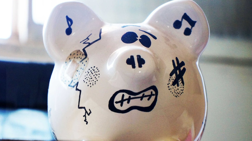 A piggy bank with cracks and bandages and a grimaced expression.