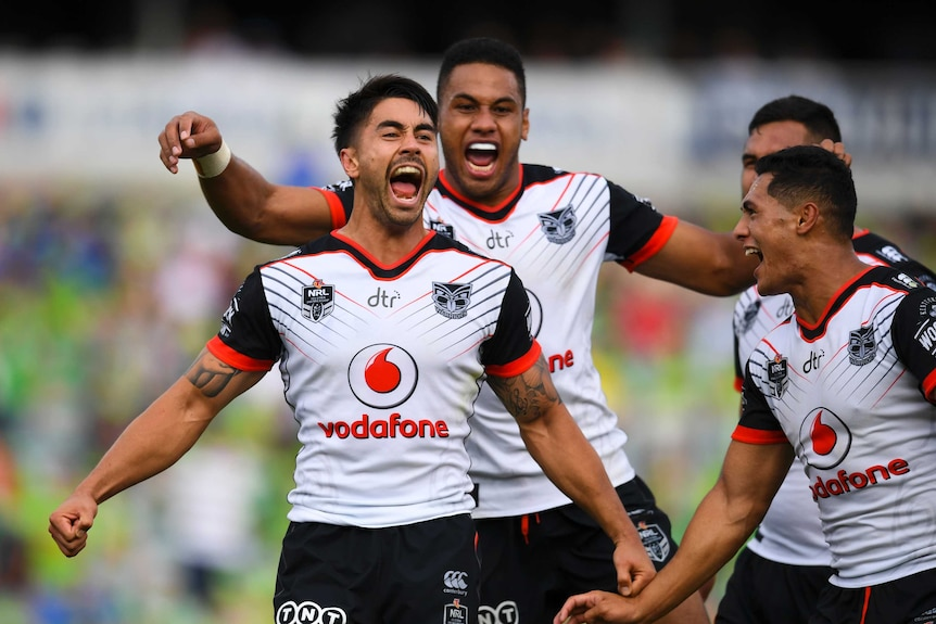 Shaun Johnson of the Warriors celebrates with team mates after winning over the Raiders in Canberra.