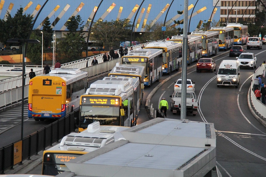 Buses queue on the Victoria Bridge as they approach the Cultural Centre busway station in Brisbane.