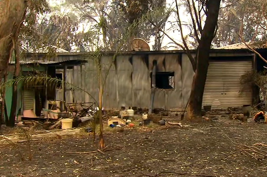 A photo of a burnt out shed or house in the Deepwater region.