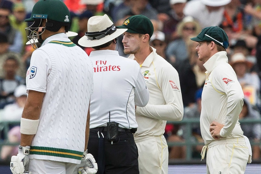 Cameron Bancroft talks to umpires in Cape Town