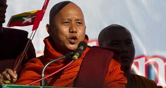 Anti-Muslim monk Wirathu addresses a pro-military rally attended by thousands of nationalist demonstrators in Yangon.