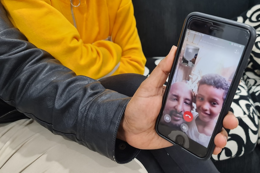 a man and a child face on a phone screen