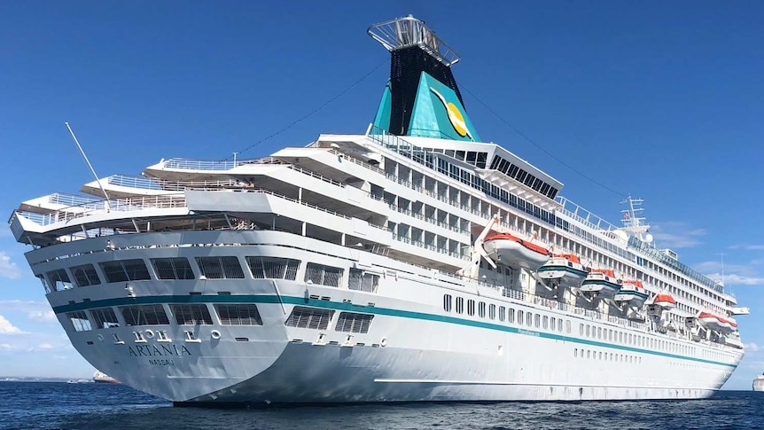 A cruise ship on the water, photographed from below.
