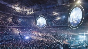 A concert inside a stadium is filled with people