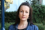Close-up shot of Australian Antipaedophile party candidate Tammara Moody standing outside.