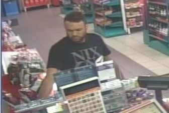 ACT Police want to talk to this man about two vehicle fires at Watson on March 5.