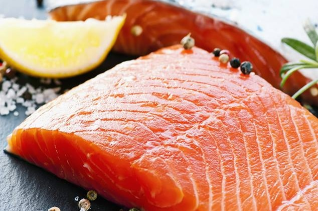 Salmon fillets on a plate.