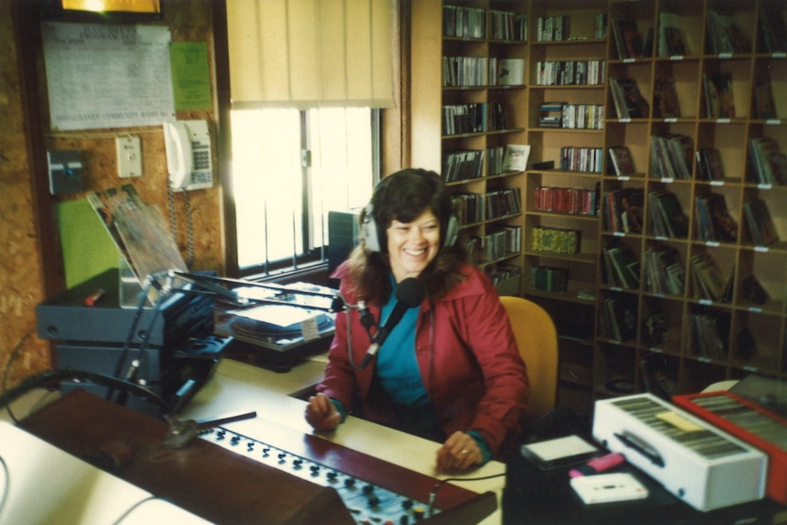 Narrell Brown sits at a radio station desk wearing headphones.