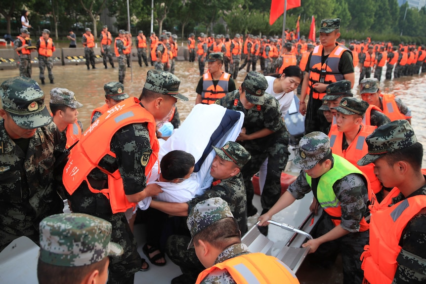 Chinese military move injured person wrapped in white