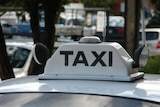 A taxi sign on the roof of an Adelaide cab