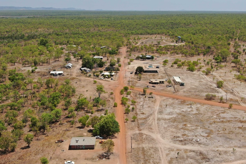 A drone photo of Mudginberri homeland in Kakadu. At least 12 homes can be seen from the air, and the water tank is visible.