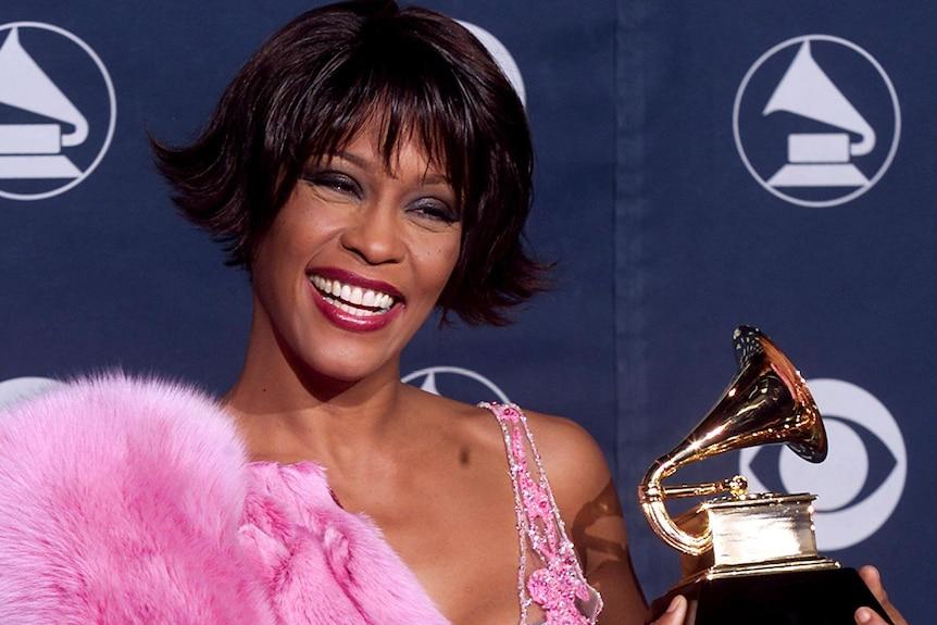 Pop diva Whitney Houston holds her Grammy award for Best Female Rhythm and Blues Vocal Performance