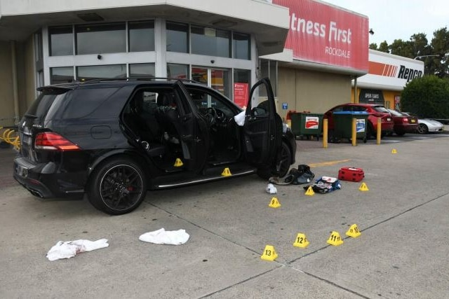 A car sits outside the Fitness First gym with police markings around it