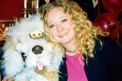 A young woman and a puppet dog.
