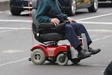 Wheelchair on road.