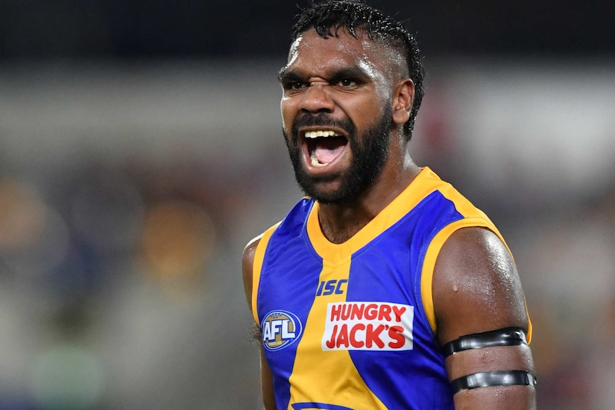 West Coast Eagles forward Liam Ryan celebrates with his fists clenched during an AFL game.