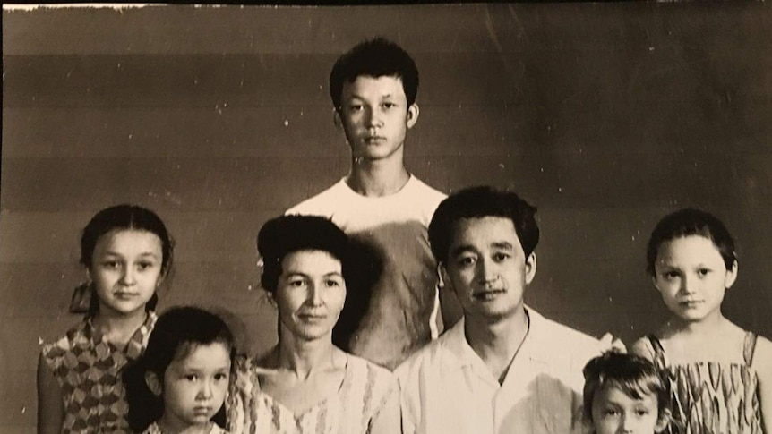 A black and white photo of a large family