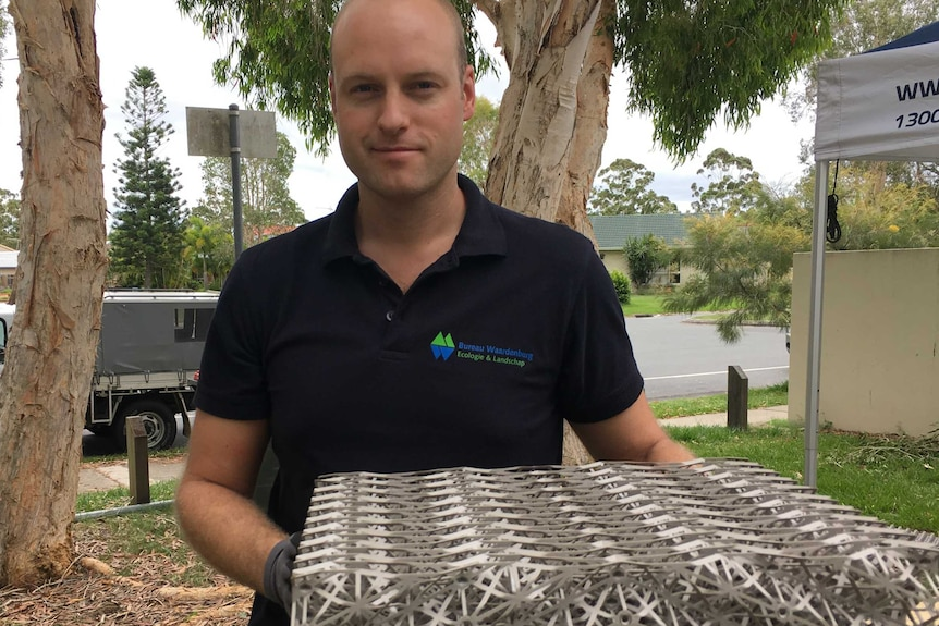 Wouter Lengkeek from the Netherlands holds a grey plastic structure.