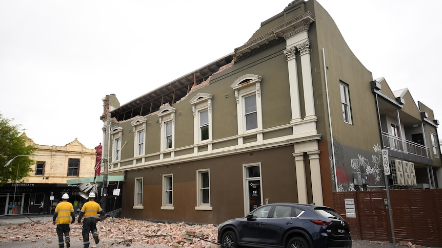 Emergency service workers on the scene of a partially collapsed building in Melbourne.