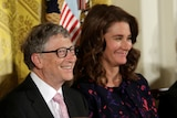 Bill Gates smiles at the camera while Melinda Gates smiles, looking in another direction.