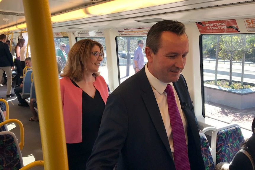 Mark McGowan and Rita Saffioti join other commuters on the train at Aubin Grove station.