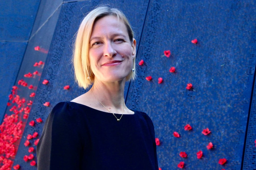 Maritime Museum chief scientist Emily Jateff smiling in front of the Shrine of Remembrance