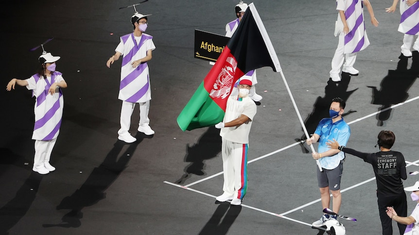 Afghanistan flag is paraded during the opening ceremony