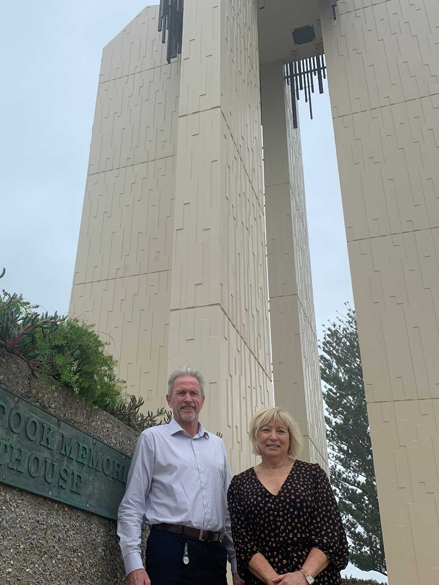 Gold Coast City Councillor Gail O'Neill and Tweed Shire Council's Stewart Brawley in front of the Point Lookout lighthouse