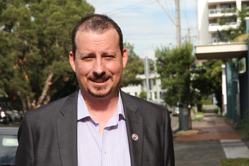 NSW Shooters, Fishers and Farmers candidate Mark Banasiak standing in a street