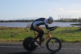 Cyclists riding in front of Hazelwood power station and the Hazelwood pondage.